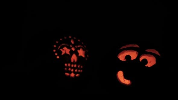 Thumbnail for Glowing in the dark spooky Jack-o-lanterns carved from real pumpkins.