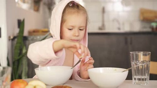 Cute Little Blonde Girl Having Breakfast Oatmeal Porridge