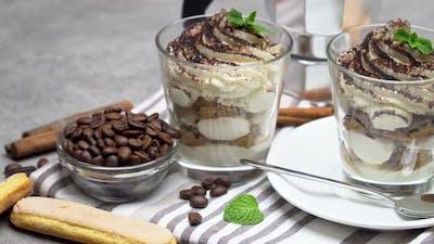 Classic Tiramisu Dessert in a Glass and Coffee Maker on Concrete Background
