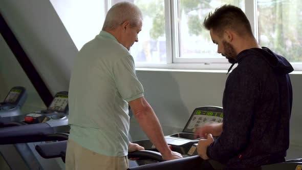 Senior Man Turns on the Treadmill