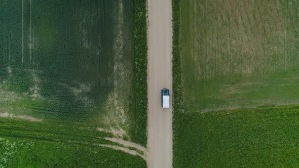Overhead Look Of Car Driving On Gravel Road In Countryside