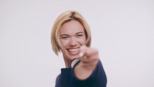 Joyful Middleaged Caucasian Blonde Female Jumping Dancing Laughing Smiling Screaming Yes on White