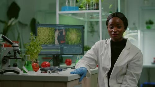 Pov of African Woman Sitting at Desk Table in Pharmaceutical Laboratory