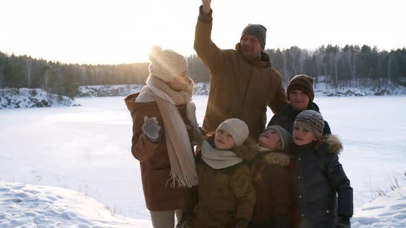 Thumbnail for Winter-Loving Family Taking Selfies Together