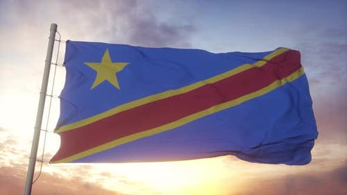 Democratic Republic of the Congo Flag Waving in the Wind Sky and Sun Background