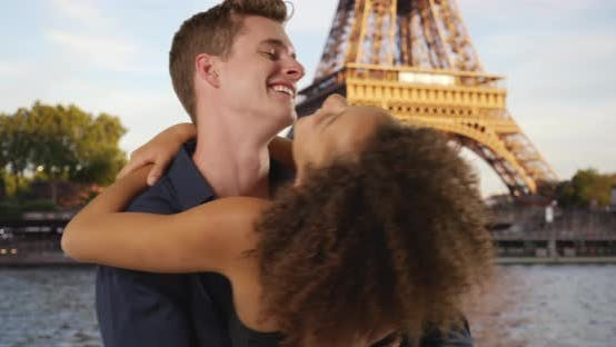 Thumbnail for Happy youthful couple hugging in front of the Eiffel Tower