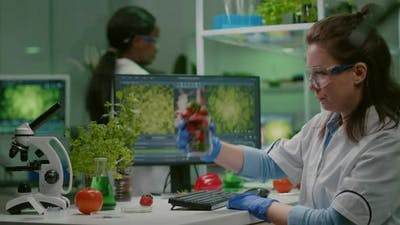 Pharmaceutical Scientist Looking at Glass with Strawberry