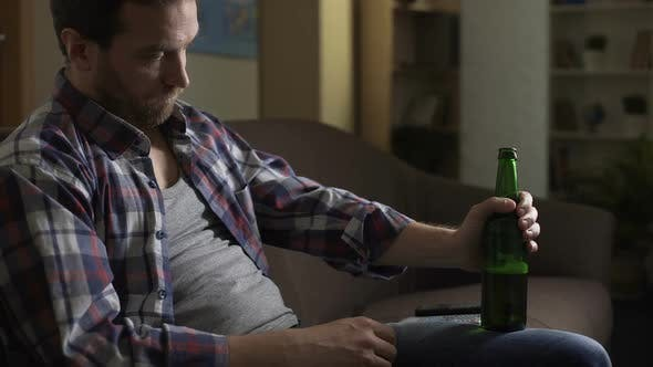 Thumbnail for Wasted Guy Sitting on Couch, Drinking Beer, Alcoholism, Psychological Problems