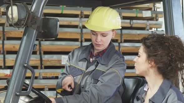 Female Forklift Operator Talking To Her Colleague While Working 1080p