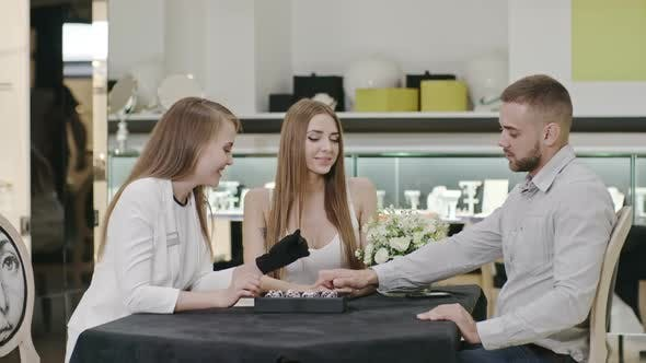 Thumbnail for Jewelry Designer Showing Rings to Couple on  Shop Display