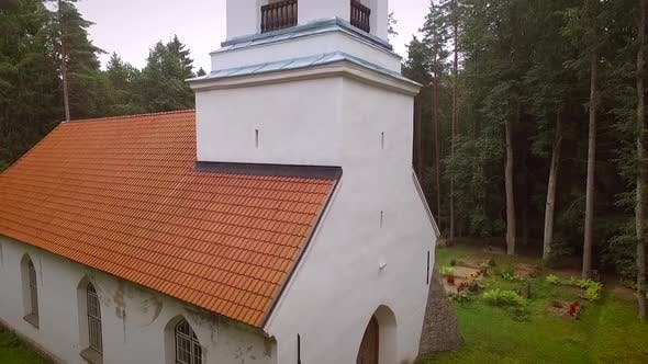 Aerial view of Orthodox Chapel located in cemetery in Estonia.