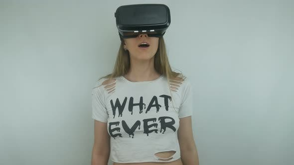 Thumbnail for Beautiful Woman Uses A Virtual Reality Helmet And Full Immersion Technology