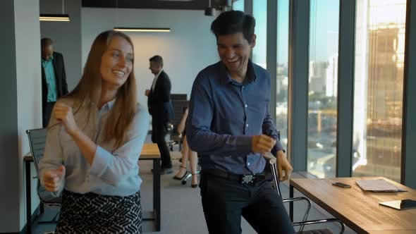 Thumbnail for Attractive Confident Colleagues Celebrating with Dance in Their Office.