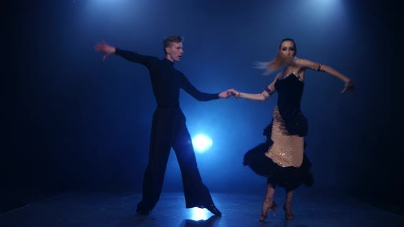 Thumbnail for Salsa Dancing Pair of Professional Elegant Dancers in Smoky Studio