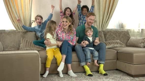 Happy Caucasian Family Watching Tv.