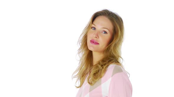 Thumbnail for Portrait of woman in pink sweater