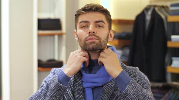 Thumbnail for Man Trying on Clothes in Store