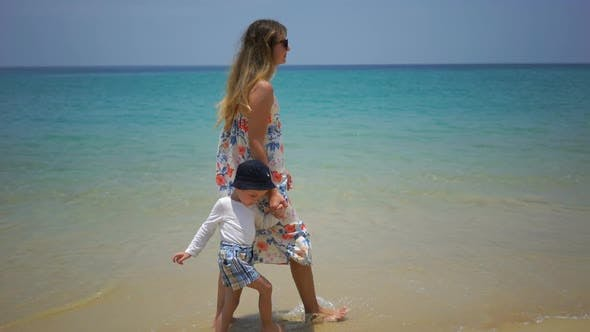 Thumbnail for Mother and Son Walking on Foot Along the Beach Near the Ocean