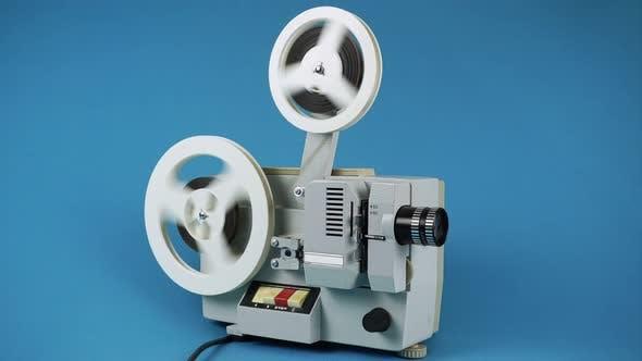 Rewinding Filmstrip On Retro Film Projector.