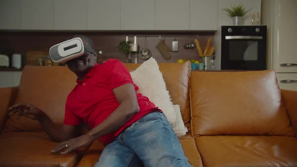Thumbnail for Elderly Black Male in Headset Playing Vr Game Indoor