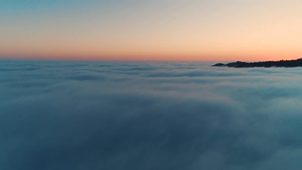 Thumbnail for Flying Over Dusk Clouds