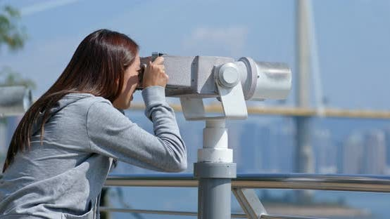 Thumbnail for Tourist look at the binocular for seeing the view in Hong Kong