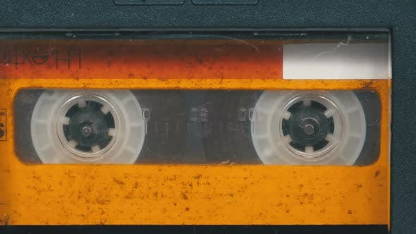 Thumbnail for The Vintage Yellow Audio Cassette in the Tape Recorder Rotates