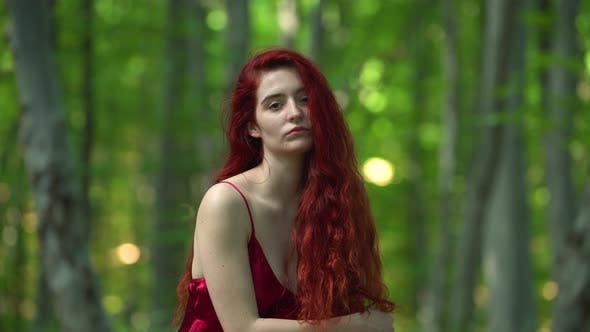 Thumbnail for A young redhead woman