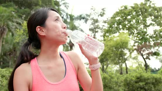 Thumbnail for Sport woman drink of water bottle
