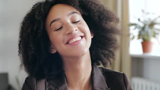 Thumbnail for Head Shot Studio Portrait of Contented Glad Curly Haired Girl, Teenager African Ethnicity with
