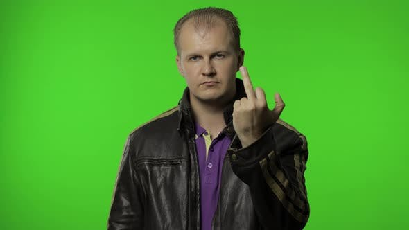 Thumbnail for Rocker Man Showing Middle Finger, Demonstrating Protest Hate, Impolite Rude Gesture of Disrespect