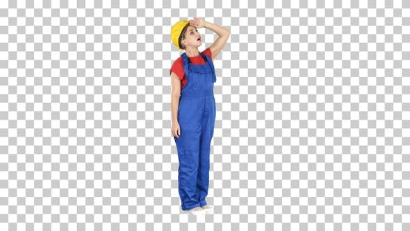 Engineer Woman in Yellow Helmet Looking up Amazed at A