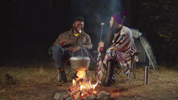 Thumbnail for Tourists Couple Eating Marshmallows By Campfire