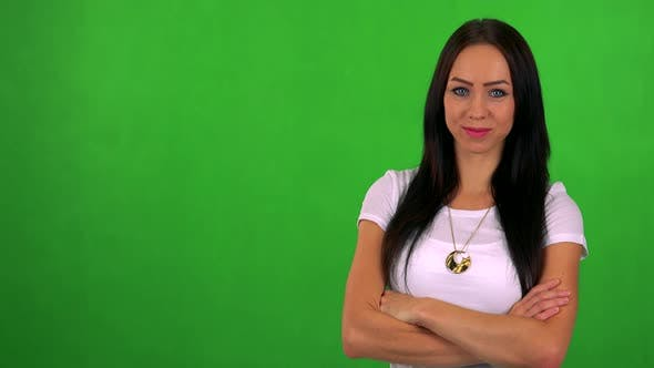 Thumbnail for Young Pretty Woman Smiles To Camera with Folded Arms - Green Screen - Studio