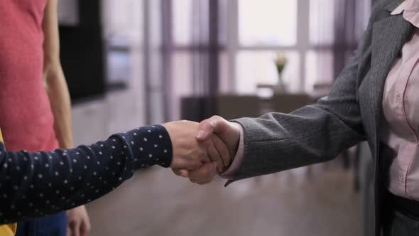 Shaking Hands with Real-estate Agent