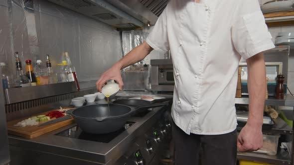 Adding Oil To Wok Pan