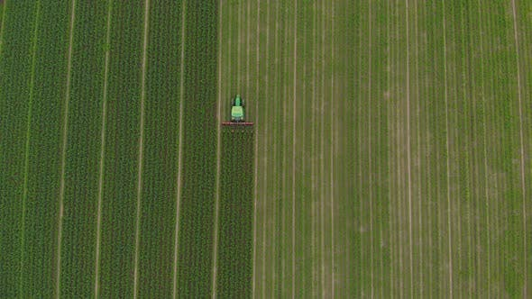 Thumbnail for Aerial: Tractor Working on Cultivated Fields Farmland, Industrial Agriculture Occupation
