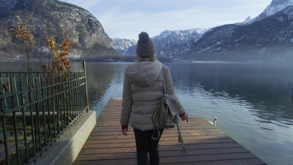 Thumbnail for Woman walking on a pontoon at Hallstatt Lake