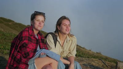 Teens Sisters are Chatting Cheerfully at Nature