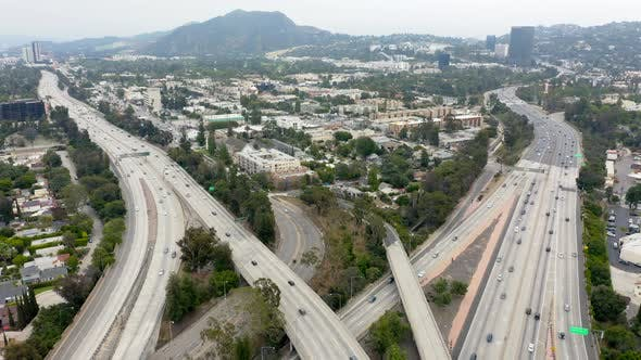 Thumbnail for . Aerial View of Los Angeles with Its Traffic on Freeways in Two Directions