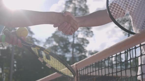 Thumbnail for Mature Couple Shaking Hands After Playing Tennis on the Tennis Court