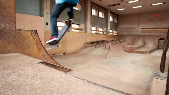 Caucasian Skateboarder Jumping High on Skateboard
