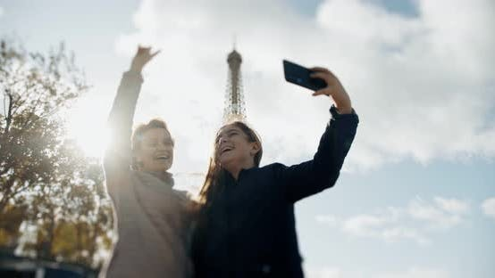 Thumbnail for Happy Loving Mother and Daughter Taking a Selfie Photo on a Smartphone and Cuddling Together, on the
