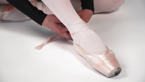 Thumbnail for The Dancer Wears Pointe Shoes on Her Feet