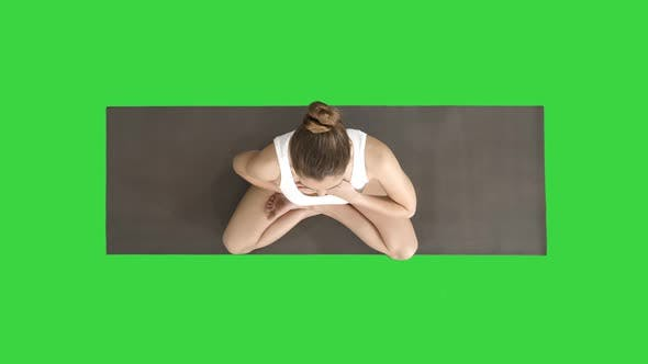 Thumbnail for Yoga Girl Breathing in Lotus Pose with Her Hands on Her Stomach and Chest on a Green Screen, Chroma