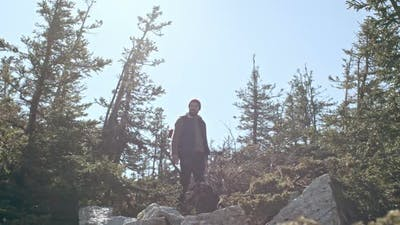 Man Lost High Up in Mountains