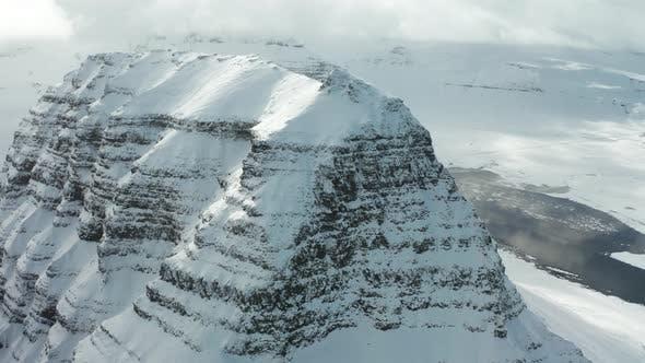 Thumbnail for Bird's-eye View of the Snowy Mount Kirkjufetl. Iceland