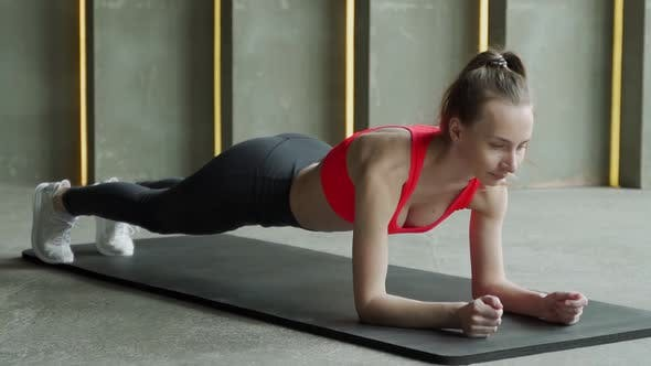 Woman Plays Sports in the Gym