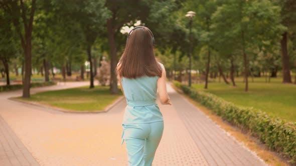 Thumbnail for Brunette Walk and Dance in Park