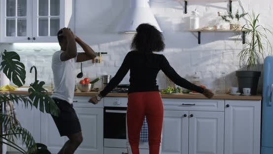 Thumbnail for Couple Dancing in the Kitchen